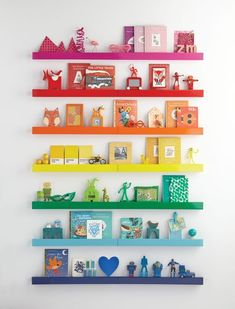 Looking for a bright and colorful way to display your favorite trinkets? Try making this easy Rainbow Ledge DIY to give any room a pop of color! #Rainbows