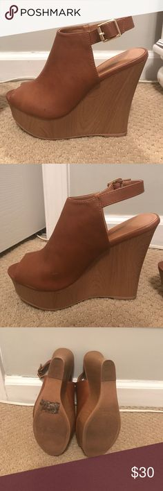 Brown wedges These cute wedges go with anything and everything and are super cute for a GNO or date night! Worn only a few times, need to sell because I had knee surgeries and can't walk in super tall heels. Shoes Wedges