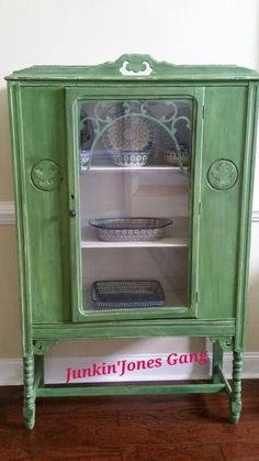 "Depression Era China Cabinet. The following ate Miss Lillian's No-Wax Chock Paint Products: Irish Creme on the inside, Ebony Glaze and Hemp Seed Oil to seal.  Body painted"" In a Pickle "" Sweet Pickins Milk Paint"