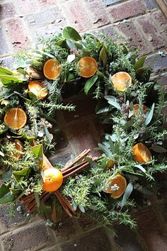 Cinnamon Twist – Taking a good ol' grapevine wreath and weaving in some fantastic foliage is an easy way to boost this simple form from drab to fab! Eucalyptus, rosemary, magnolia leaves and sliced Meyer lemons all intertwine the grapevine. A bow of cinnamon sticks further enhances the amazing aroma this wreath boasts and picks up on the color of the magnolia leaves backing. Another wreath well suited for not only the holidays, this wreath can celebrate the winter season, for citrus is a...