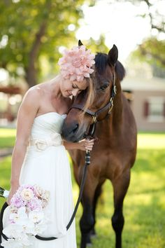 it makes sense for me to take a picture with my horse on my wedding day. After all, horses were my first love :)