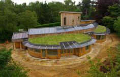 Solar grass house - a beautiful partial earthen roof home