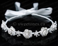 This sophisticated long veil is accented with a beautiful bow and flower in the centre of the comb.  Perfect accessory to complement First Holy Communion dress, flower girl dress, or any formal outfit. Comes as pictured.