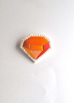 Geometric brooch hand made embroidered orange faux gem