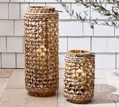 Whether placed on the back porch or taking center stage on a mantle, the Waverly Handwoven Water Hyacinth Lantern lends itself to a laid-back, beachy vibe. When paired with one of our flickering flameless candles, it adds charm, texture and ambian… Brass Lantern, Lantern Set, Lantern Candle Holders, Solar Lanterns, Metal Lanterns, Pottery Barn Lanterns, Candle Lanterns, Front Door Accessories, Garden Accessories