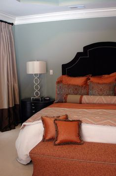 master bedroom with orange accents