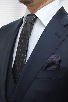 Navy suits,double cuff shirts,wooltie and silk chief