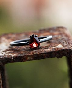 Black oxidised silver and garnet engagement ring from Claudette Treasures #wedding