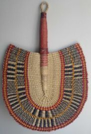 Hand made in Ghana by a rural women's cooperative guided by Fair Trade policies, this fan from the Bolgatanga region is woven with the abund...