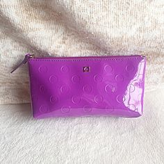 KATE SPADE NY PURPLE LITTLE SHILOH CAMELLIA STREET 100% guaranteed authentic. 7 3/4 X 2.5 X 4 Retail Price:  $55 Style No.:  WLRU1791 Color: purple  Zippered Closure Tan Interior Lining with 1 slip pocketNO TRADES OR QUESTION COMMENTS FROM NON SERIOUS BUYERSDO NOT BUNDLE UNLESS YOU INTEND TO BUYDO NOT LOWBALL kate spade Bags Cosmetic Bags & Cases
