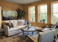 Cozy, Comfortable Living Room - A rich, muted orange shade enhances the cozy comfort of this neutral living space.