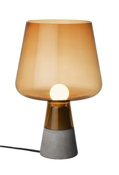 Iittala is proud to debut Leimu, a new lighting piece by young Norwegian-born designer, Magnus Pettersen. As its flame-evoking name suggests, the copper-brown Leimu creates a relaxed atmosphere for enjoyable moments in good company. With its strong concrete base, the impressive glass lamp portion, i