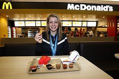 Gold medal-winning freestyle skiier Hannah Kearney of the United States enjoys a victory meal of Chicken McNuggets and Sweet Chili Sauce at the McDonald's restaurant at the Main Press Center during the 2010 Olympic Winter Games in Vancouver    #McDonald's #mcdonalds #Olympics
