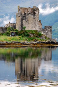 Eilean Donan Castle, Scotland. Built in the 13th century to hold back the Vikings, it is situated on an island surrounded by the scenic Scottish highlands.