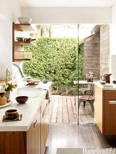 Tear down walls, enlarge windows, or swap solid doors for glass to open up views and connect adjacent spaces. Or create visual stumbling blocks with new walls or strategically placed screens or shelving that force you to take in the space slowly — suggesting that it's larger than it is. | Design Mark Egerstrom