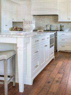 Encore Ceramics | 3x6 field tile hand-glazed in Silver crackle adds just the right amount of color to this white kitchen with walnut floors | Design by Liz Schupanitz Designs in Plymouth, MN