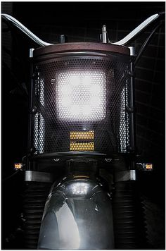 Jambon Beurre Motorcycle. LED front Light behind a steel grid. Golden power…