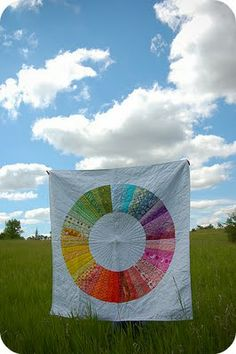 Color Wheel Quilt - I have never wanted a quilt more than I want this one! There's the design nerd in me again LOL