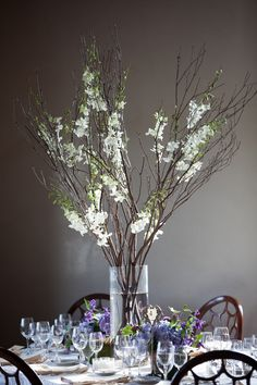 Flowers/Arrangements/Table Decor: Want some tables with long branches (willow? Spruce? Eucalyptus, etc...) with smaller low arrangements and candles.  Could use wine bottles for table numbering (with mountain summit info)