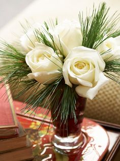 Pretty Christmas Flower Arrangements Add one of these pretty Christmas floral arrangements to your holiday decor. These flowers, including poinsettias, roses, and amaryllis, will brighten your Christmas displays. Rose Flower Arrangements, Christmas Flower Arrangements, Christmas Flowers, Christmas Centerpieces, Floral Centerpieces, White Christmas, Christmas Holidays, Christmas Crafts, Christmas Decorations