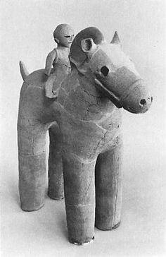 The person who rides a horse. The Kofun period (AD.250-AD.592) art, Haniwa terracotta clay figure. Gunma Japan.