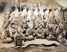 Ainu group outside hut, ca. 1880 by Tamoto Kenzo