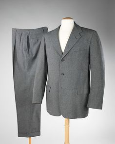 Grey flannel suits were very popular among business men in particular during the 1950s. These replaced the English drape cut - being suits with less padded shoulders and a more narrow silhouette in comparison. The shades of grey available varied, but dark grey/charcoal was perhaps the most popular color.