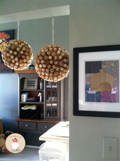 DIY Wine Cork Balls Would love to have different size ones above my cabinents with the decor :) Better get to drinking