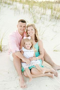 family of three on the beach