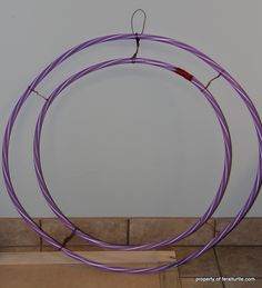 A Giant Wreath - Make a giant wreath from hula hoops! Wrapping burlap and wire around two hula hoops gave me a perfect base for creating a giant wreath for my s…