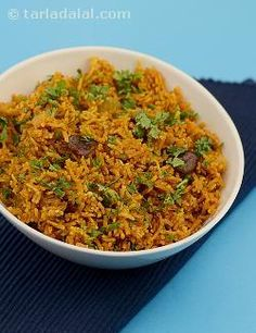 Maharashtrian food can safely be called simple yet intelligent. The ingredients are usually well-chosen, and cooked in a quick yet tasty way with minimal spices. You would even find a lot of single-pot recipes. Here is such a mildly-spiced rice delicacy from the kitchens of that state. It is quite easy to make, but you should ensure that each grain of the cooked rice is separate. Also, do not forget to stir it every 5 minutes for even cooking.