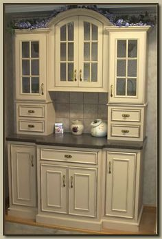 I like this for my kitchen. Tall antique painted hutch with granite counter top