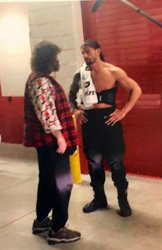 Mick Foley with Roman Reigns at WM31<---Romans pissed with Foley that he gave his unstable lunatic brother a baseball bat with barbed wire