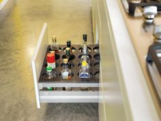 Kitchen bottle drawer. I REALLY love this idea! They don't take up space in the freezer or countertop!!