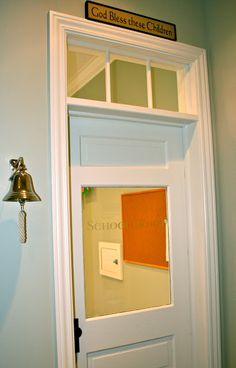 I love the door on this homeschool room! Like a school, but NOT.  August Fields: the school room. school is now in session!