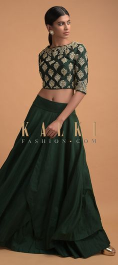 Buy Online from the link below. We ship worldwide (Free Shipping over US$100)  Click Anywhere to Tag Forest Green Skirt And Crop Top With Zari And Zardozi Embroidered Buttis Online - Kalki Fashion Forest green skirt in cotton with layered hem.Paired with a matching crop top in raw silk adorned with sequins, zari and zardozi embroidered buttis in leaf pattern