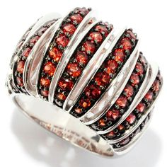 2.9ctw Red Garnet Nine-Row Dome Band Ring for just $40 with our 20% discount coupon code : HAPPYHOLIDAYS20 . . Main Stone Name: Red Garnet Main Stone Weight (in carats): 2.45 Main Stone Color: Red Main Stone Shape: Round Main Stone Grading: 2A Main Stone Setting: PAVE Main Stone Treatment: Not Enhanced Main Stone Creation Method: Natural Birth Month of Main Stone: January Total Carat Weight (All Stones): 2.91 Total Metal Weight (in grams): 8.29