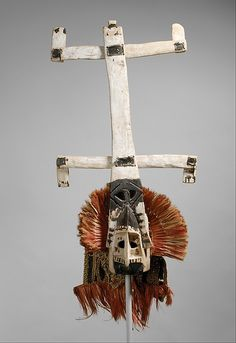 Mask (Kanaga) - One of the most popular types of masks in the Sanga region is the type known as kanaga. Like other Dogon masks, kanaga masks are worn at rituals called dama, whose goal is to transport the souls of deceased family members away from the village and to enhance the prestige of the deceased and hi...