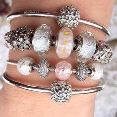 Pandora Spring combo, (snow on the ground), with lovely new Essence beads. #theofficialpandora #uniqueasyouare #dopandora #doinspire #murano #glassbeads #frosty #shimmer #daisies #daisylove #essencecollection #joy #balance #happiness #fieldofdaisies #pandoralover #pandoraaddict #pandorabracelet #pandorabeads #pandorabangle #essence #springtime #docelebrate