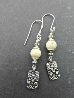Silver hoops, with argentium silver ear wire, silver wire wrapping and lotus flower silver charms. Earrings are lightweight and measure about 2 1/2 inches. As with all of my jewelry these earrings are