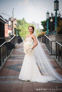 This bride is too gorgeous! Photos in downtown Rochester, NY before her wedding reception at the Inn on Broadway. Photos by Rochester wedding photographer Katie Finnerty. http://www.katiefinnertyphotography.com/blog/2015.9.17.inn-on-broadway-rochester-wedding-clare-drew