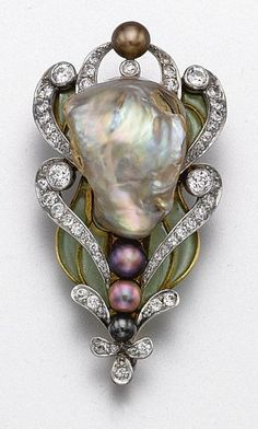 Baroque Pearl, Plique-a-Jour Enamel & Diamond Brooch (c. 1900)The stylized floral motif decorated with a baroque pearl of pale gray color with pastel overtones, and with 4 smaller pearls of aubergine, black and bronze hue, framed by scrolls of old European-cut diamonds and leaves of green plique-à-jour enamel, mounted in 18 karat gold, signed Marcus & Co.