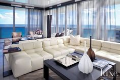 Two leather B&B Italia sofas are set back-to-back to unify yet divide the living and media areas. An L-shaped sofa enveloping a custom Christian Liaigre cocktail table creates the media room with views of the Atlanitc Ocean from every vantage point. B&b Italia Sofa, Miami Beach Condo, Beach House, Miami Houses, Interior And Exterior, Interior Design, Living Room Lounge, L Shaped Sofa, Home Theater Design
