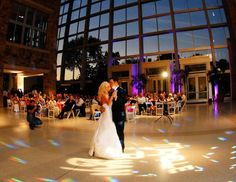 The bride and groom dance during their wedding at the Indiana State Museum