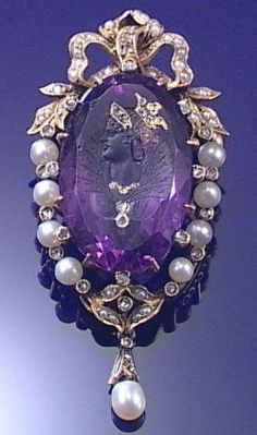 A VICTORIAN PEARL AND AMETHYST BROOCH/PENDANT, 1860s. The oval amethyst carved with the profile of an Elizabethan Lady accented with rose-cut diamond detail, set within a pearl and rose-cut diamond frame, surmounted by a bow and suspending a pearl drop. #Victorian #brooch #pendant: