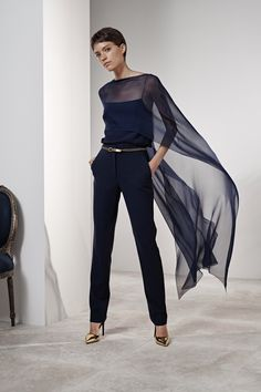 The dramatic elegance of a silk cape draped over a tonal camisole and  tailored bc6138f5a29