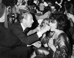 Halston hand feeds Liz Taylor a slice of birthday cake during a bash at Studio 54 in March 1978. Speaking of birthdays ...