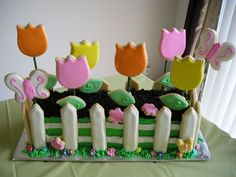 They made the FENCE out of cookies, too.  That is clever. We could do butterflies and ADORABLE bee cookies too!