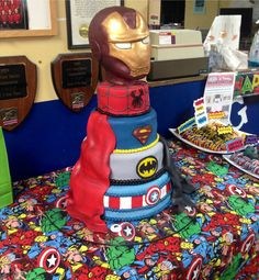 Snapped a shot before the party of the side cape. Superhero montage cake from today! Fondant covered. Spider-Man, Super man, Batman, and Captain America. Four tiers of white buttermilk with Swiss Buttercream. Iron man decorative keepsake topper. For Hayden's 7th birthday.