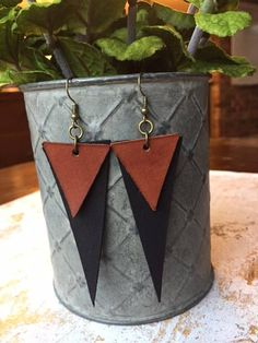 This listing in for a pair of double triangle leather earrings! You can pick any combination of these three colors: dark brown, light brown and black. Light brown and black are pictured in this listing. If you have any special size requests feel free to send me a message.
